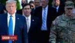 US military chief sorry for joining Trump walk