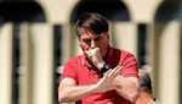 Brazil's Bolsonaro ordered to wear mask in public