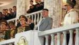 North Korea holds military parade with missiles