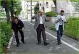 All 3 generations of Godzilla suit wearers walking down the street together.